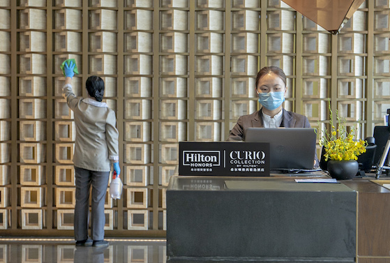Cleaning the lobby of Hilton's Curio Xiamen, China