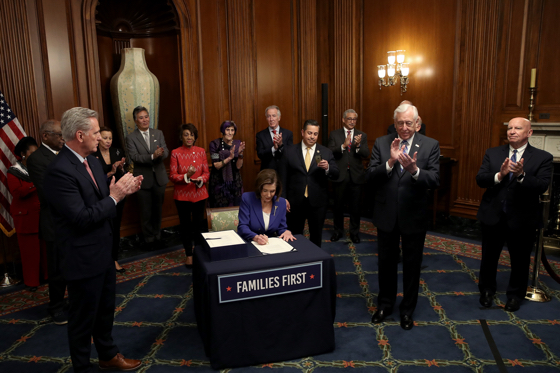 U.S. House of Representative leader Nancy Pelosi signs CARES Act (Getty Images)