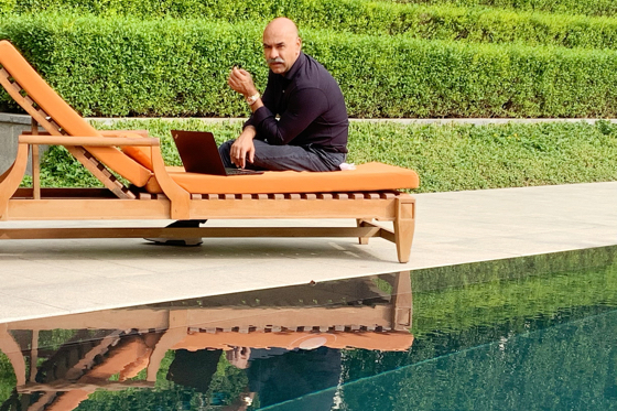 Jay Rathore working, last week, at an unusually empty poolside at The Oberoi, New Delhi